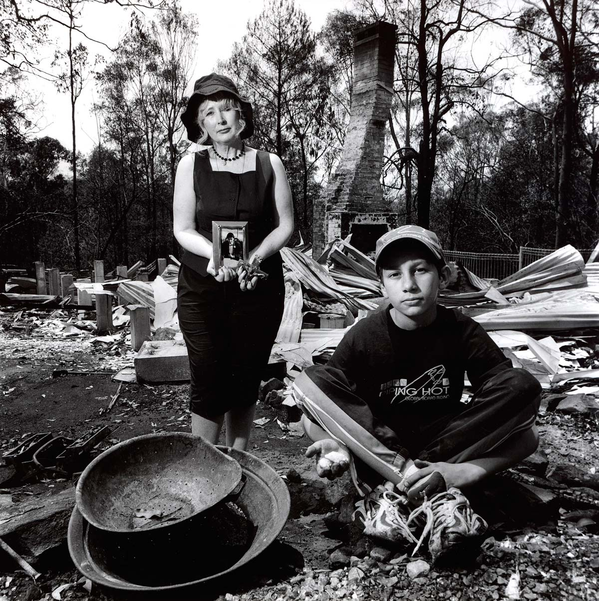 Josephine Quigley with her grandson Aaron, in the ruins of their home - Black Christmas Bush Fires 2001