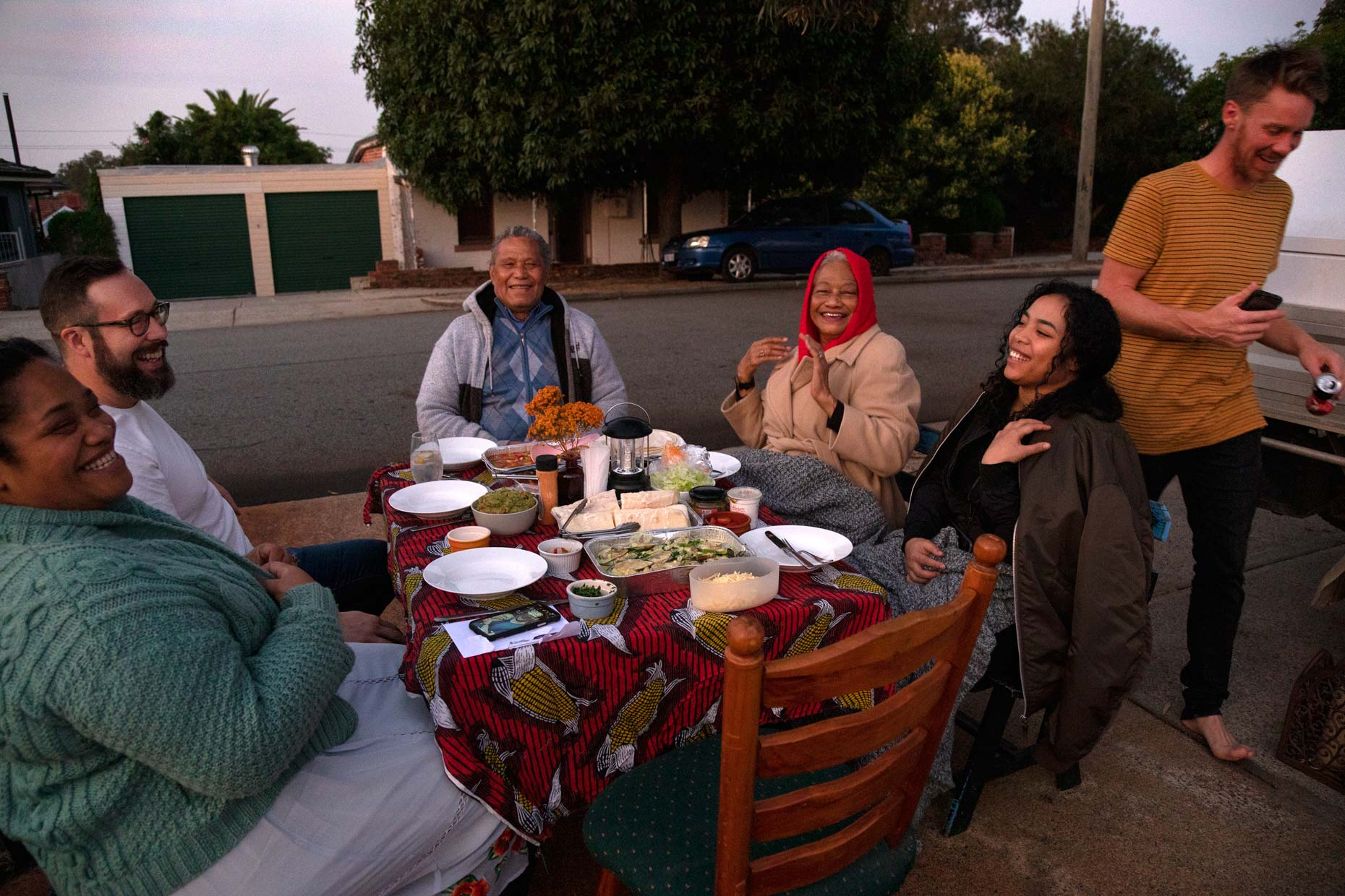 Family enjoying a driveway dinner during COVID-19 lockdown