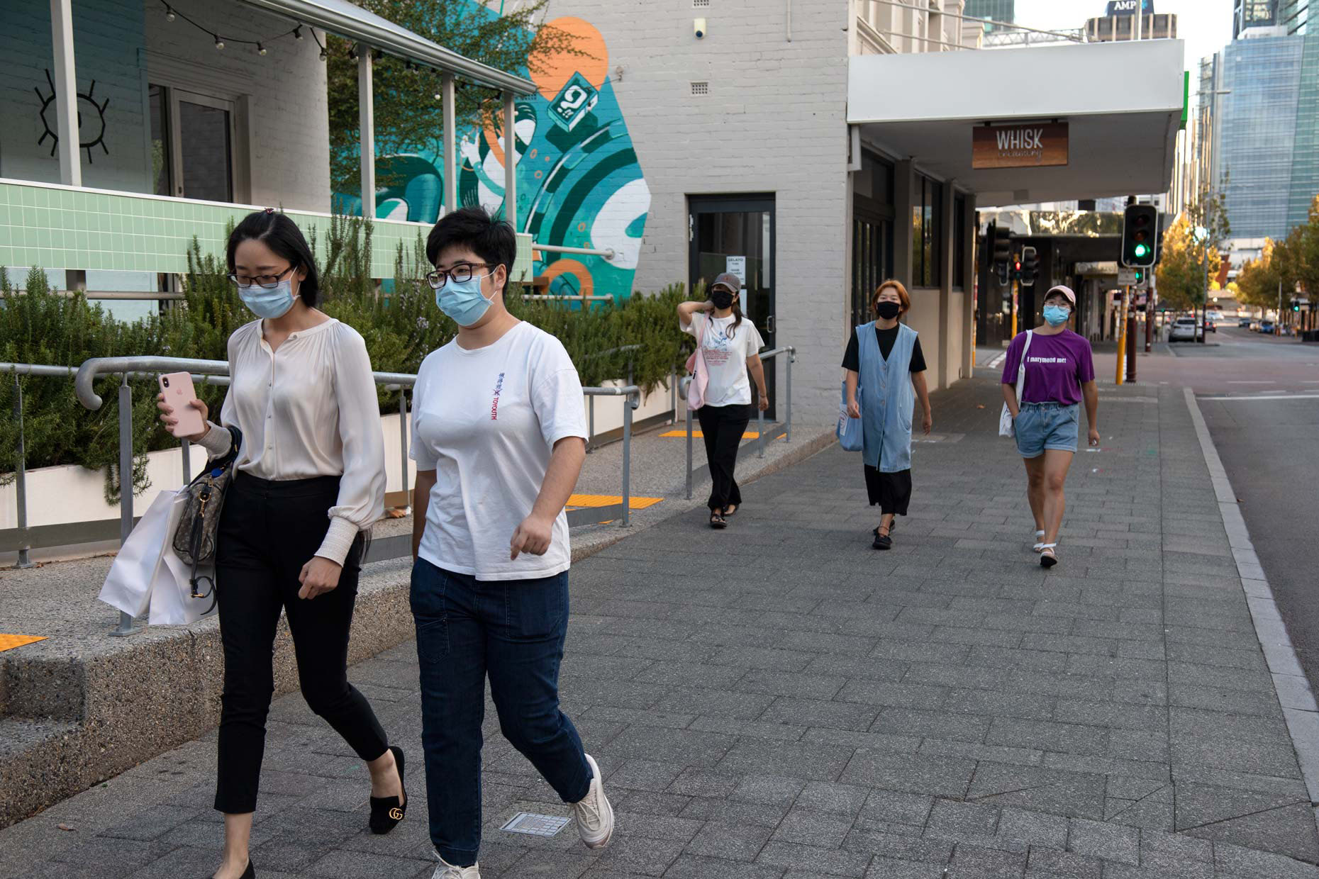 Young women wearing face masks during COVID-19 lockdown on William Street